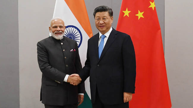Meeting of Prime Minister with Mr. Xi Jinping, President of the People's Republic of China on the margins of the 11th BRICS Summit